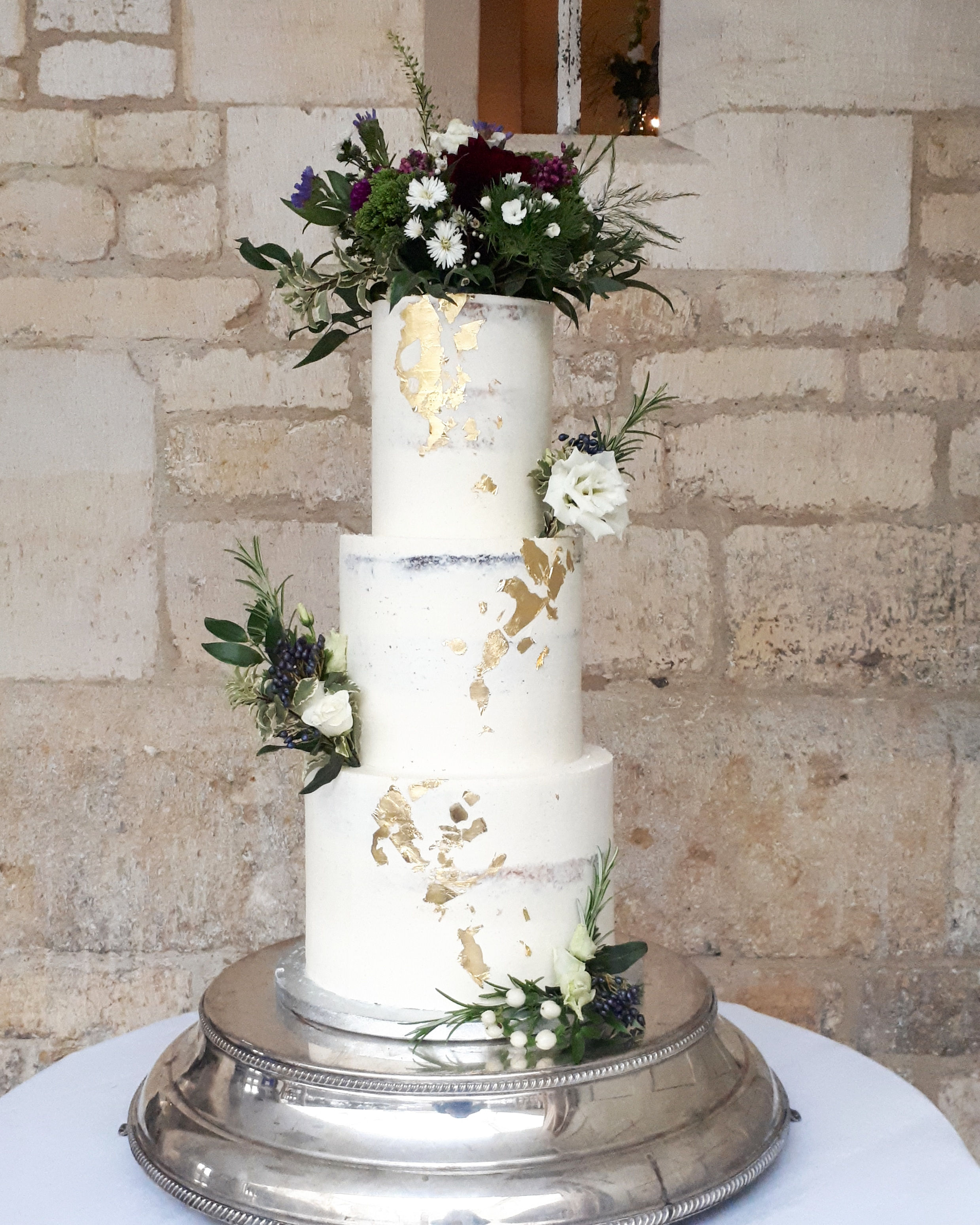 white and gold semi naked wedding cake