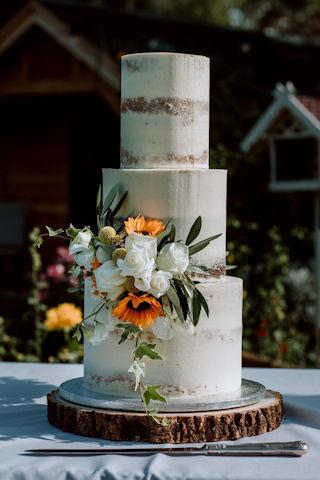 Semi-Naked Wedding Cake With Autumnal Flowers
