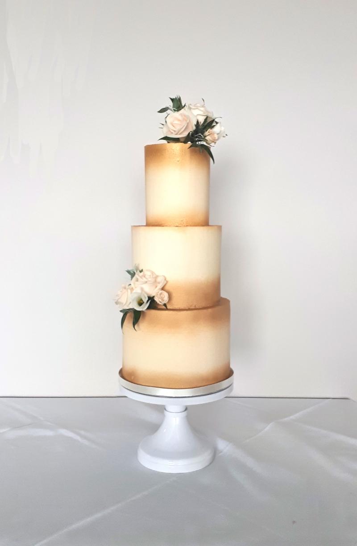 gold and white buttercream wedding cake
