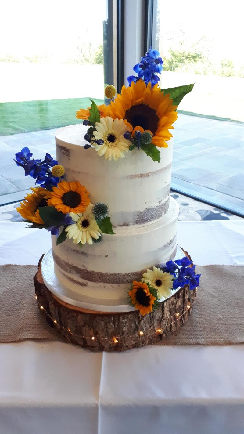 sunflower semi naked wedding cake
