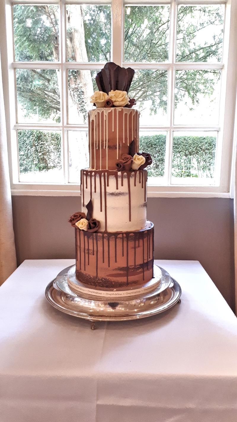 chocolate drip semi naked wedding cake