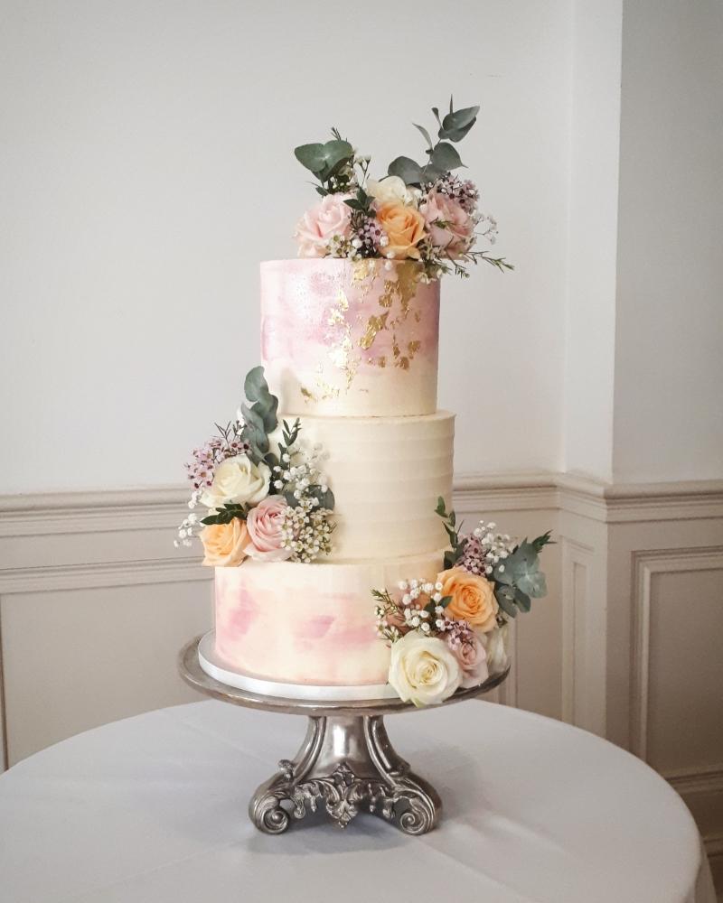peach pink buttercream wedding Cake with fresh flowers