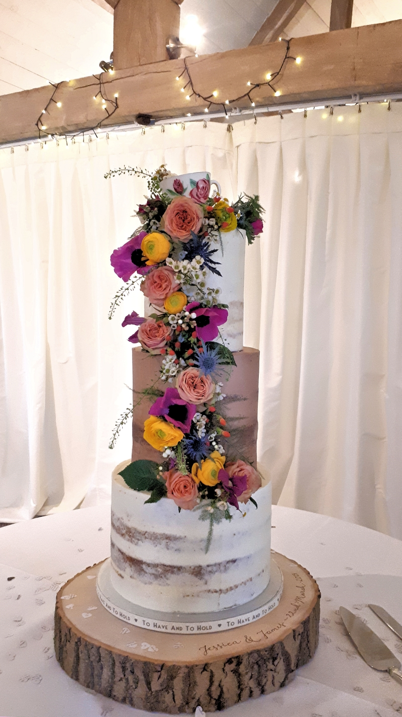 semi naked wild flowers wedding cake