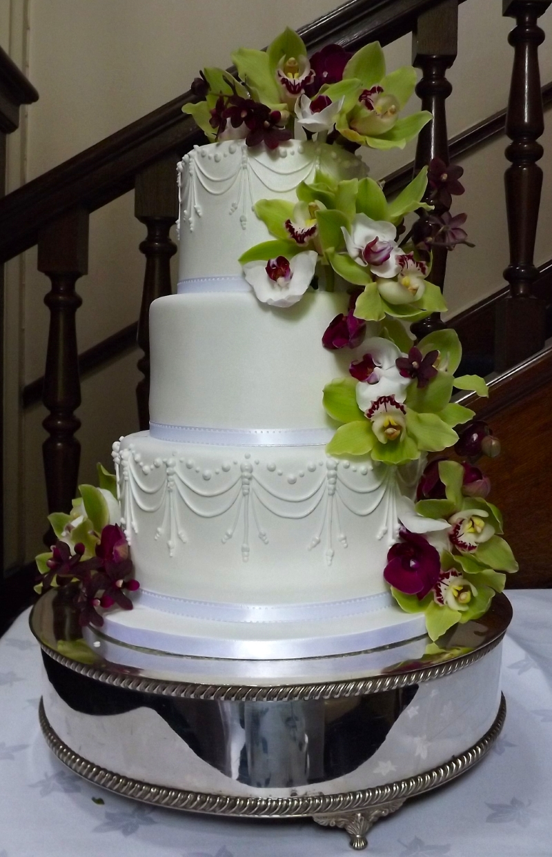fresh orchid lily white wedding cake