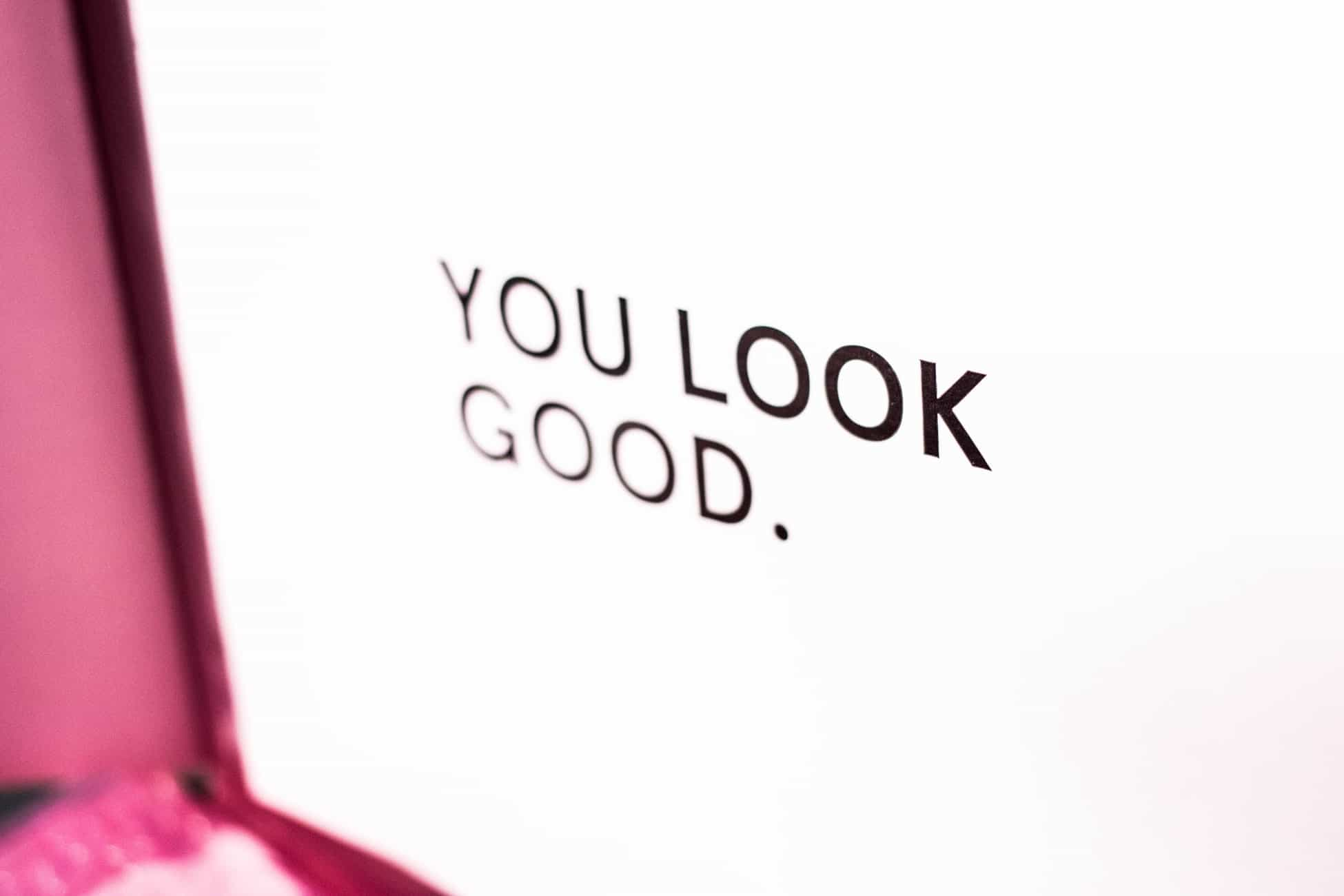 Computer screen showing the text 'YOU LOOK GOOD'
