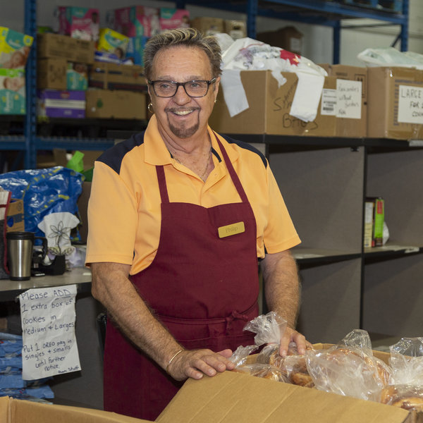 Man volunteering at food bank