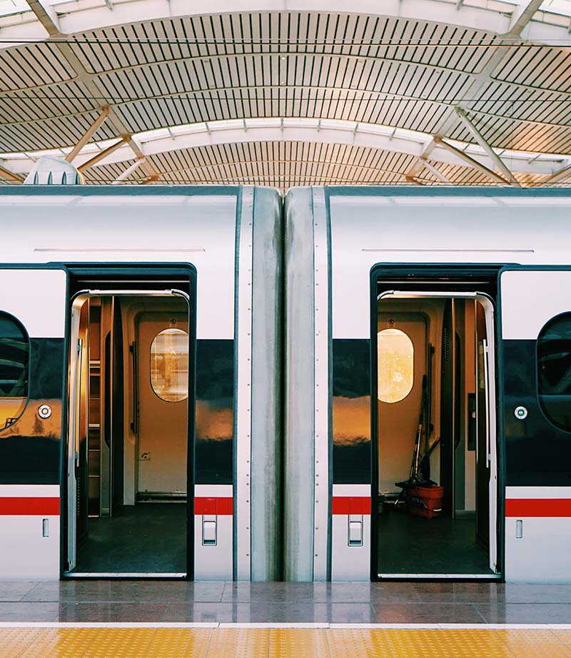 Rail System Solutions train doors open at the platform
