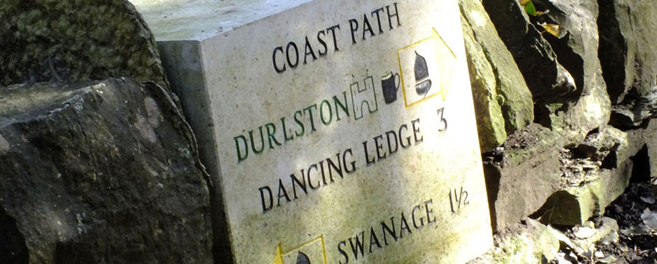 Concrete signpost at Durlston Country Park