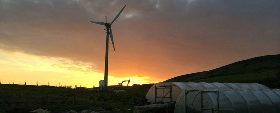 Sunset behind Godlingston Manor wind turbine