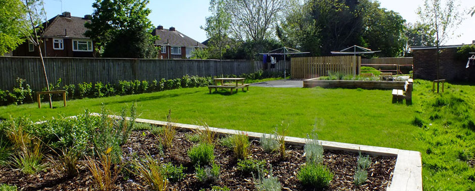Raised beds and seating at Sovereign Housing Association