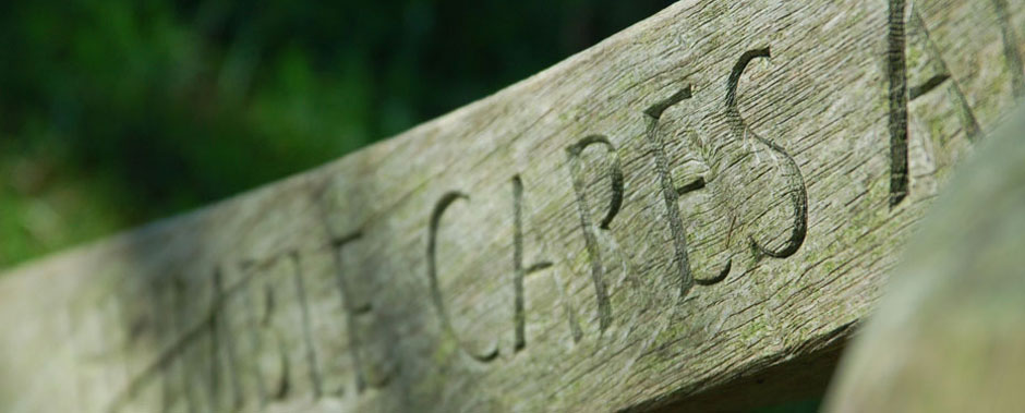 Carved lettering in wood at Highlands Farm