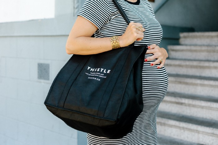 pregnant woman with thistle bag