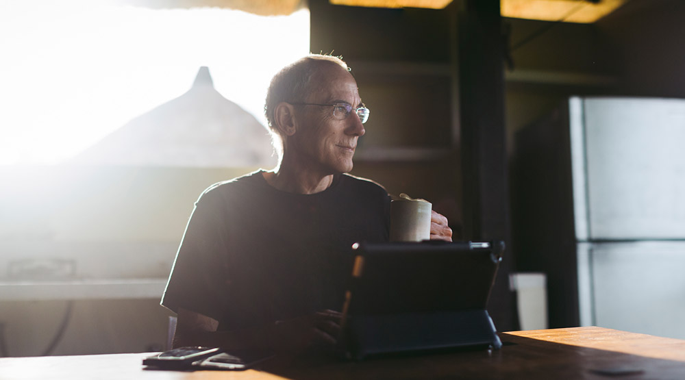 A man drinking coffee while reducing his taxes
