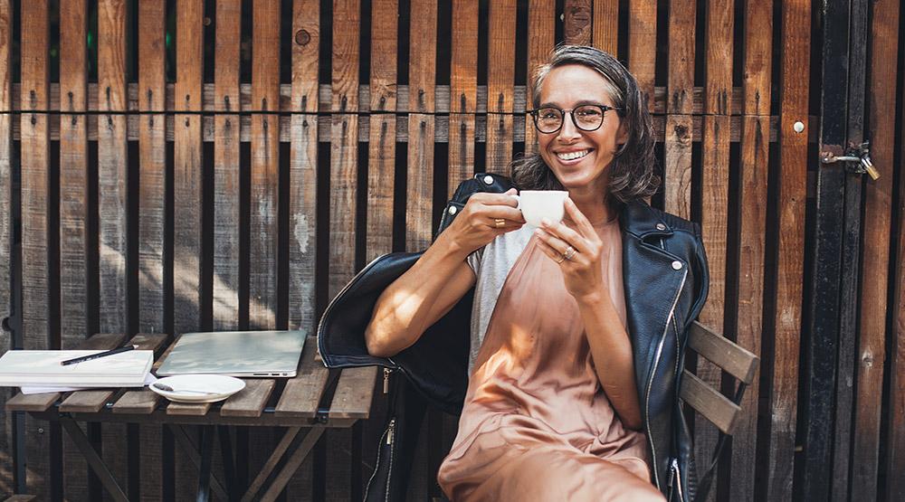 A woman enjoying coffee in retirement.