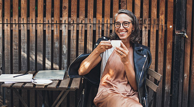 A woman enjoying coffee in retirement.