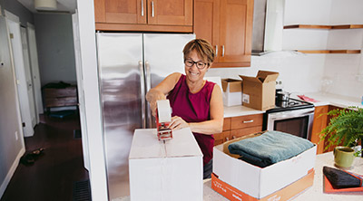 A woman getting ready to move to a new house after downsizing in retirement.