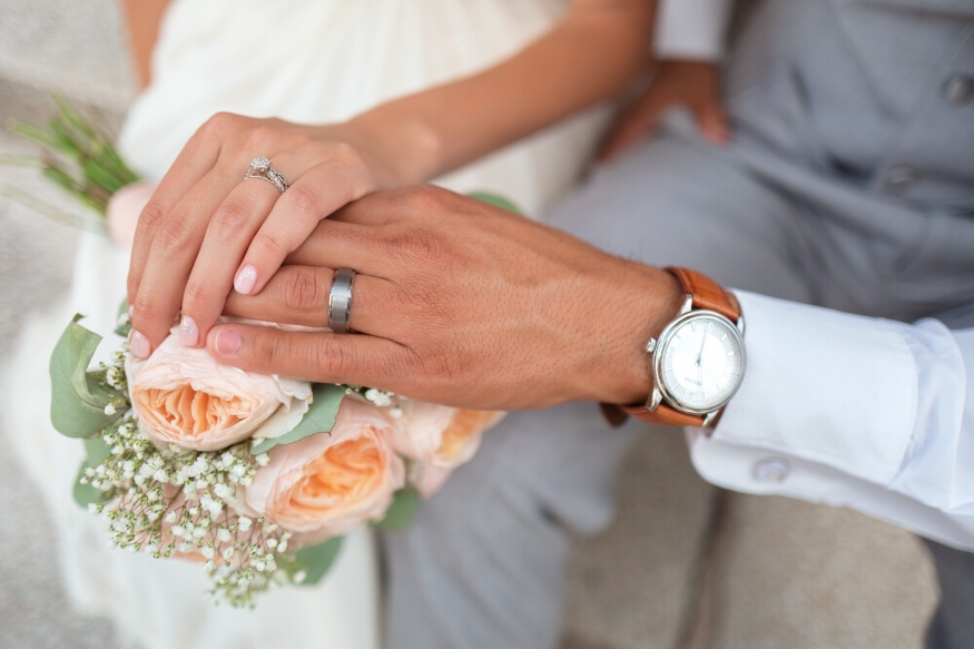 Newly-Wed Couple Hands and Rings