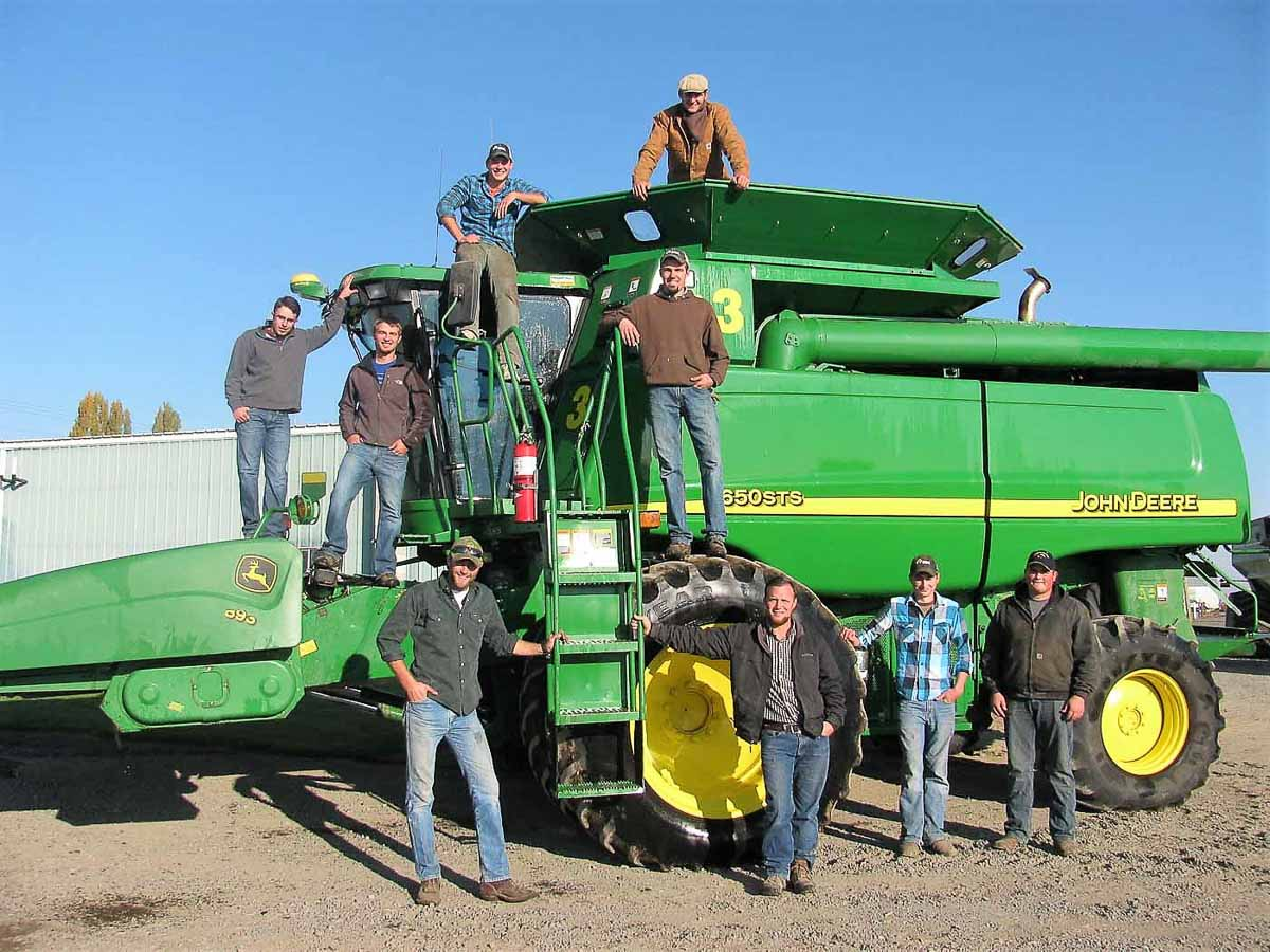 Picture of part of Victory Ag and Victory Farms team posing on harvester.