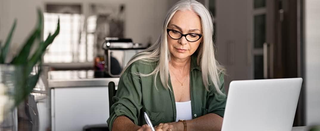 Woman exploring advantages of ACH payments