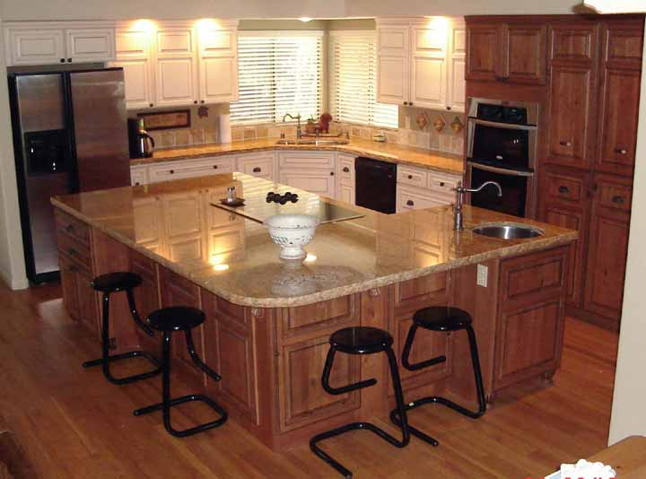 Country kitchen with island bar, wood cabinets and cream countertop