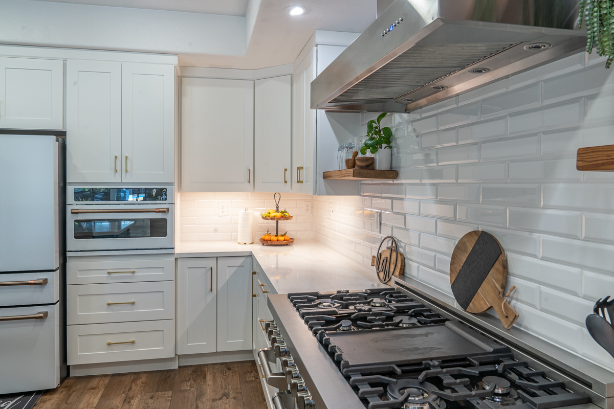 A bright white contemporary kitchen with warm accents.