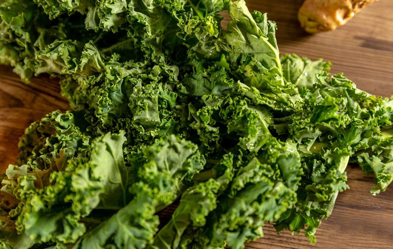 Leafy greens on a table.