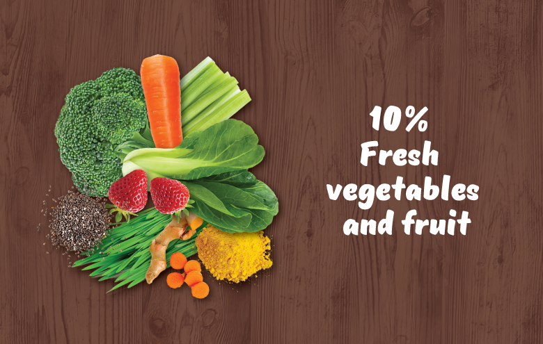 Vegetable and fruits on a wooden background and copy saying that 10 % of fresh vegetables and fruit are part of a complete and balanced raw food diet.
