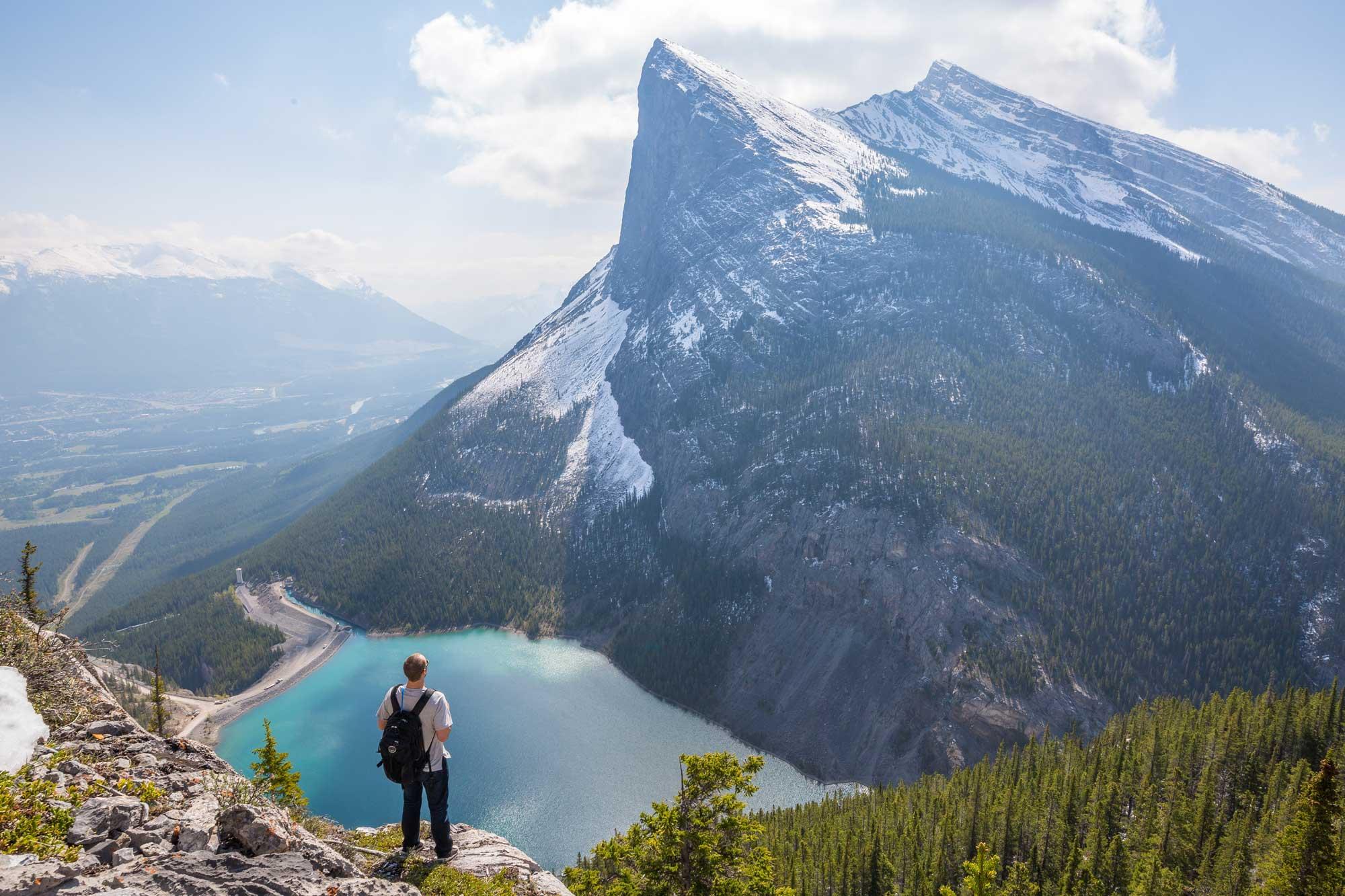 photo of man on enormous mountain