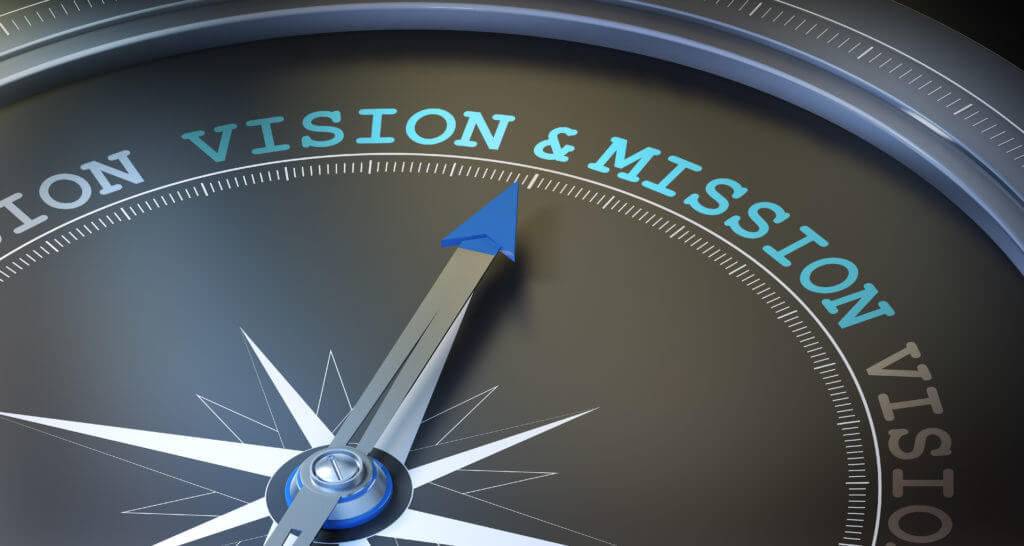 compass dial pointing to vision & mission