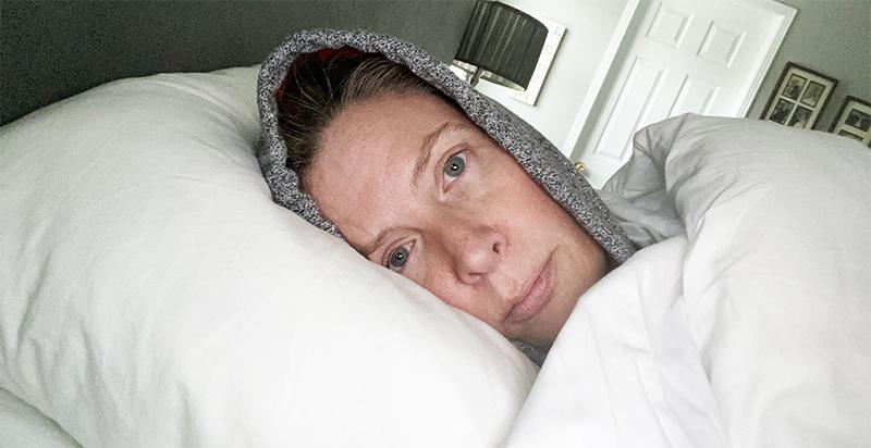 Kristy lying in bed