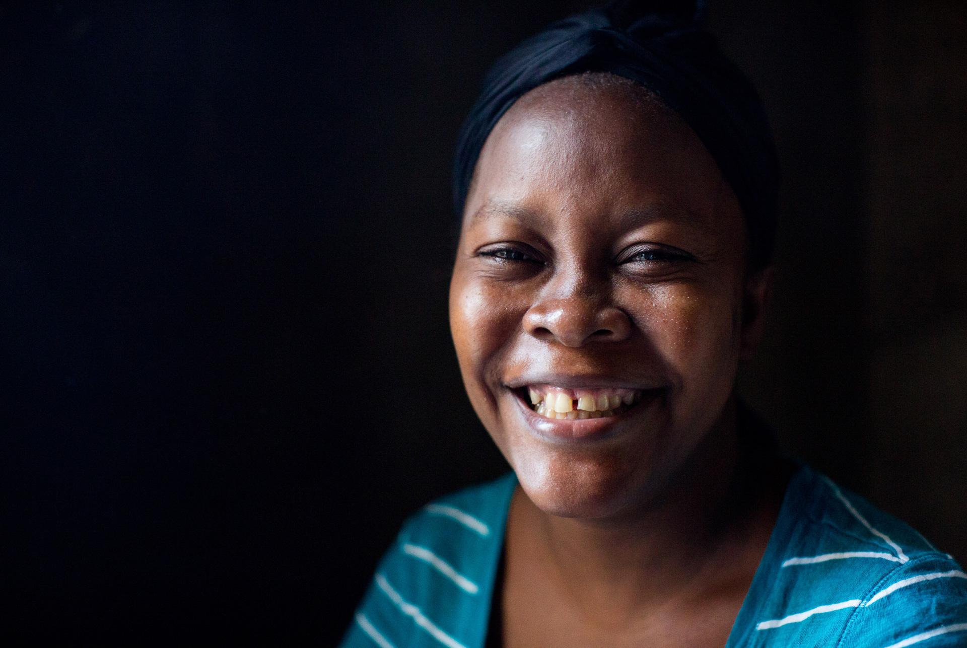 Headshot of woman smiling.