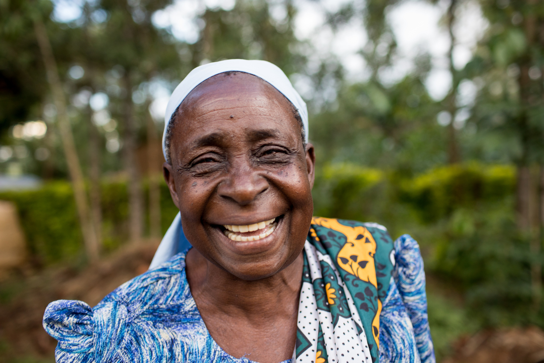 Headshot of older woman smiling.
