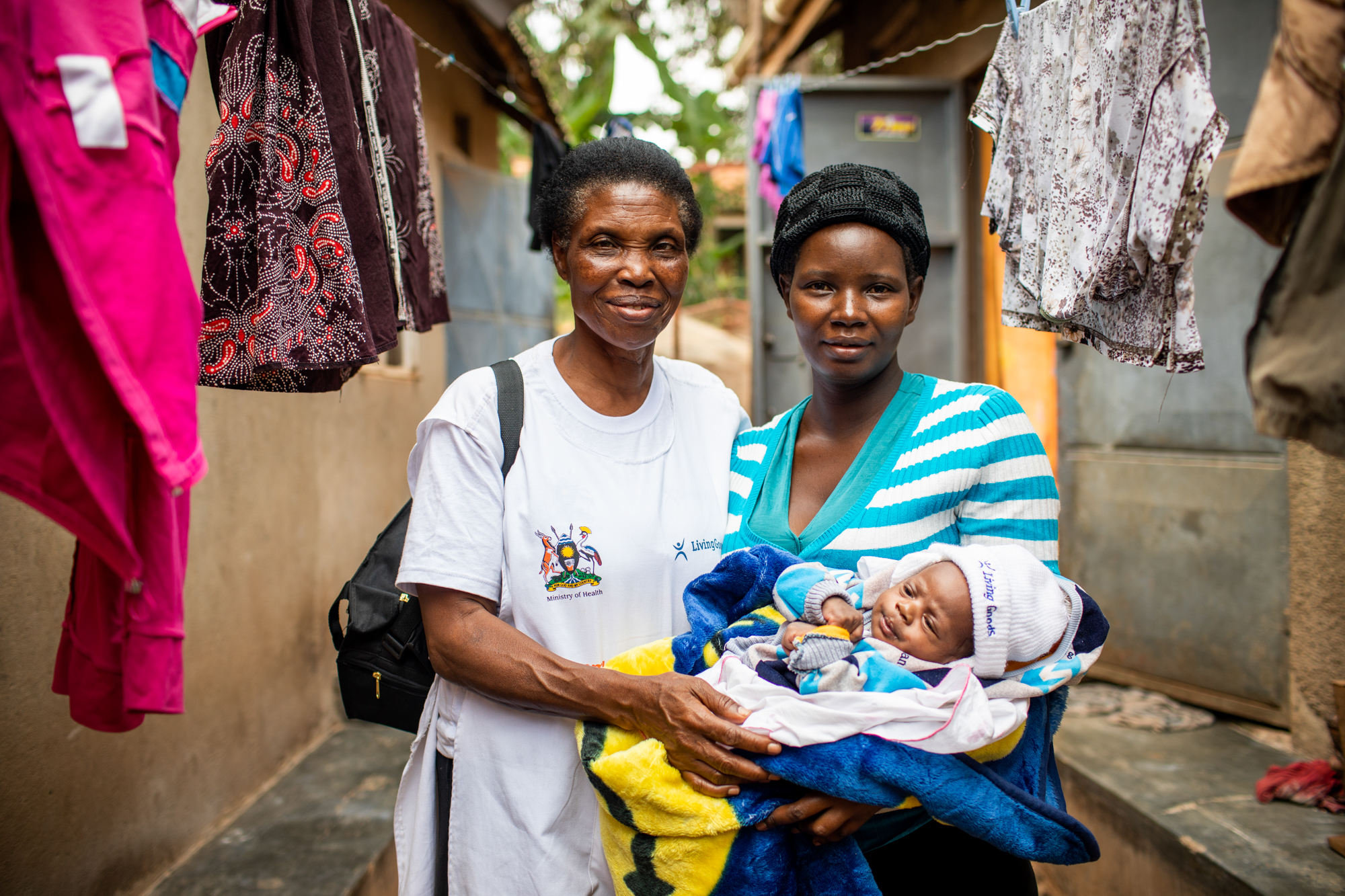 Joy, a Community Health Promoter in Uganda, checks in on a mom and her newborn.