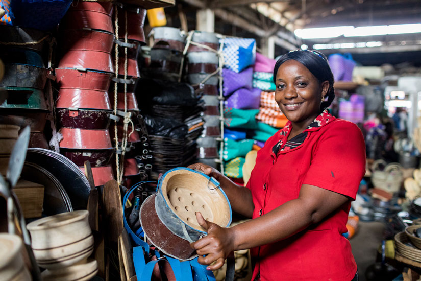 Business woman smiling while holding a stove.
