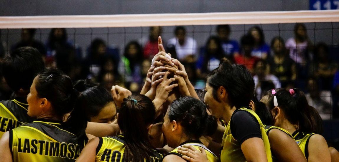 Women volleyball team in yellow jerseys