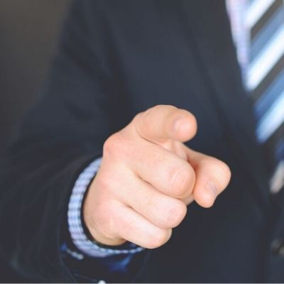Man in tie pointing his finger