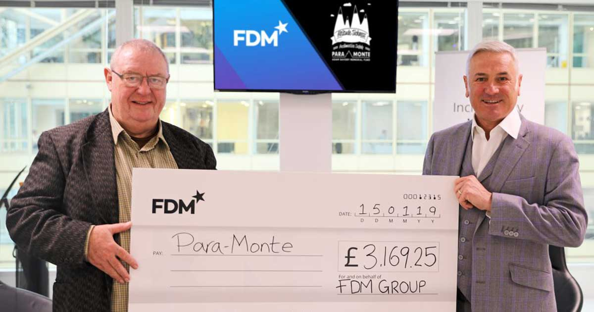 Picture of Chris receiving the donation from FDM