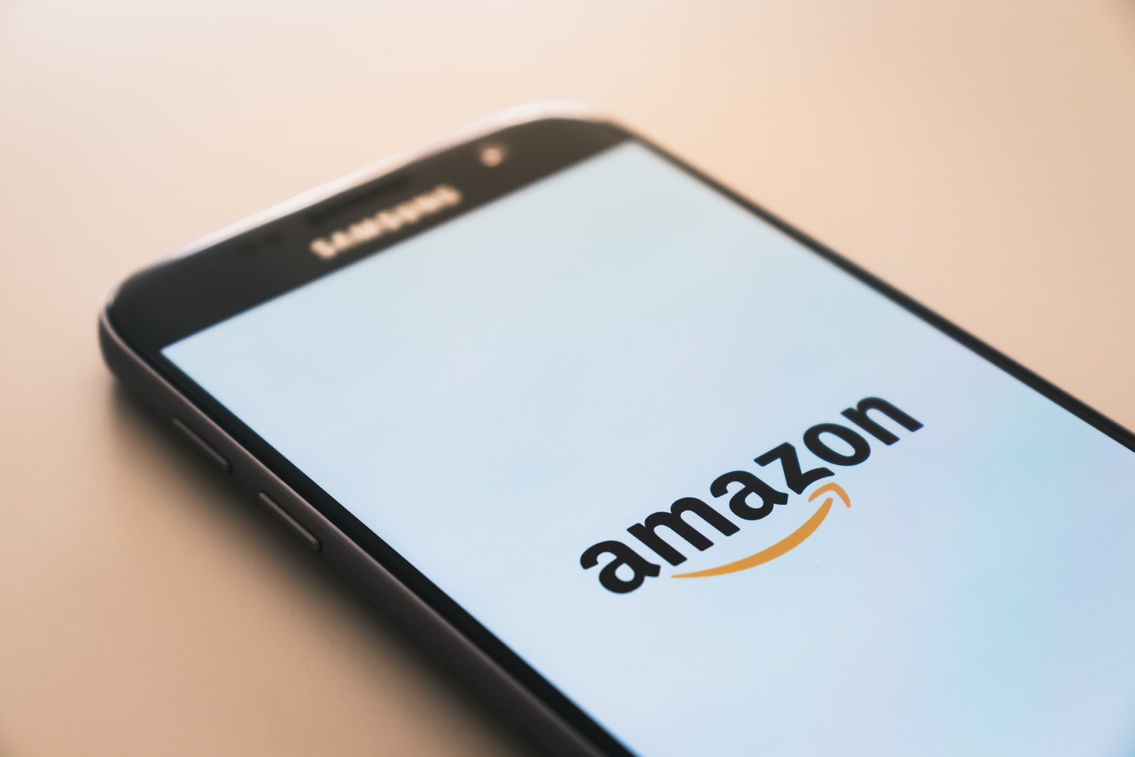 Amazon as an example of a great delivery policy – photo of Amazon logo on a phone