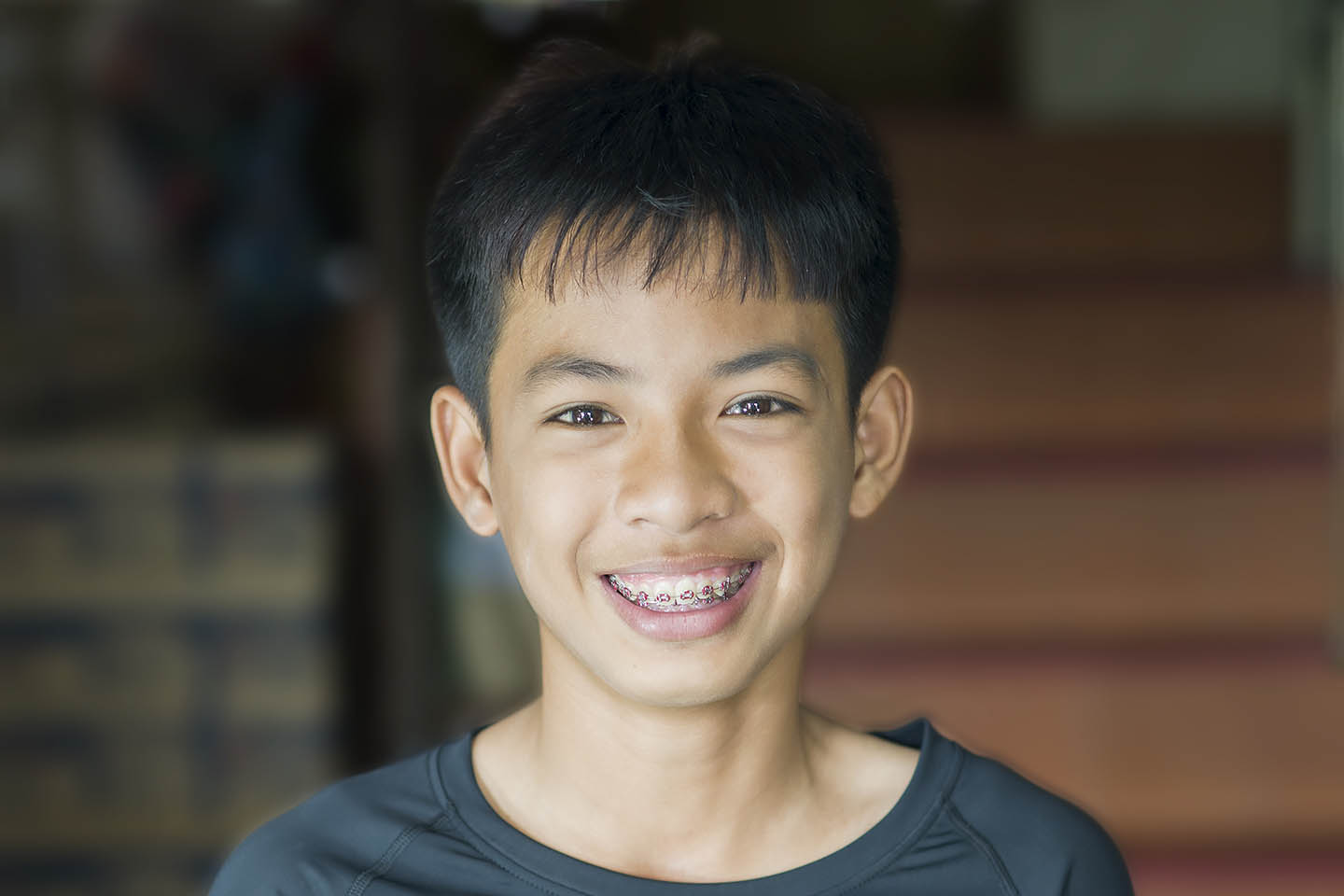 boy smiling with braces