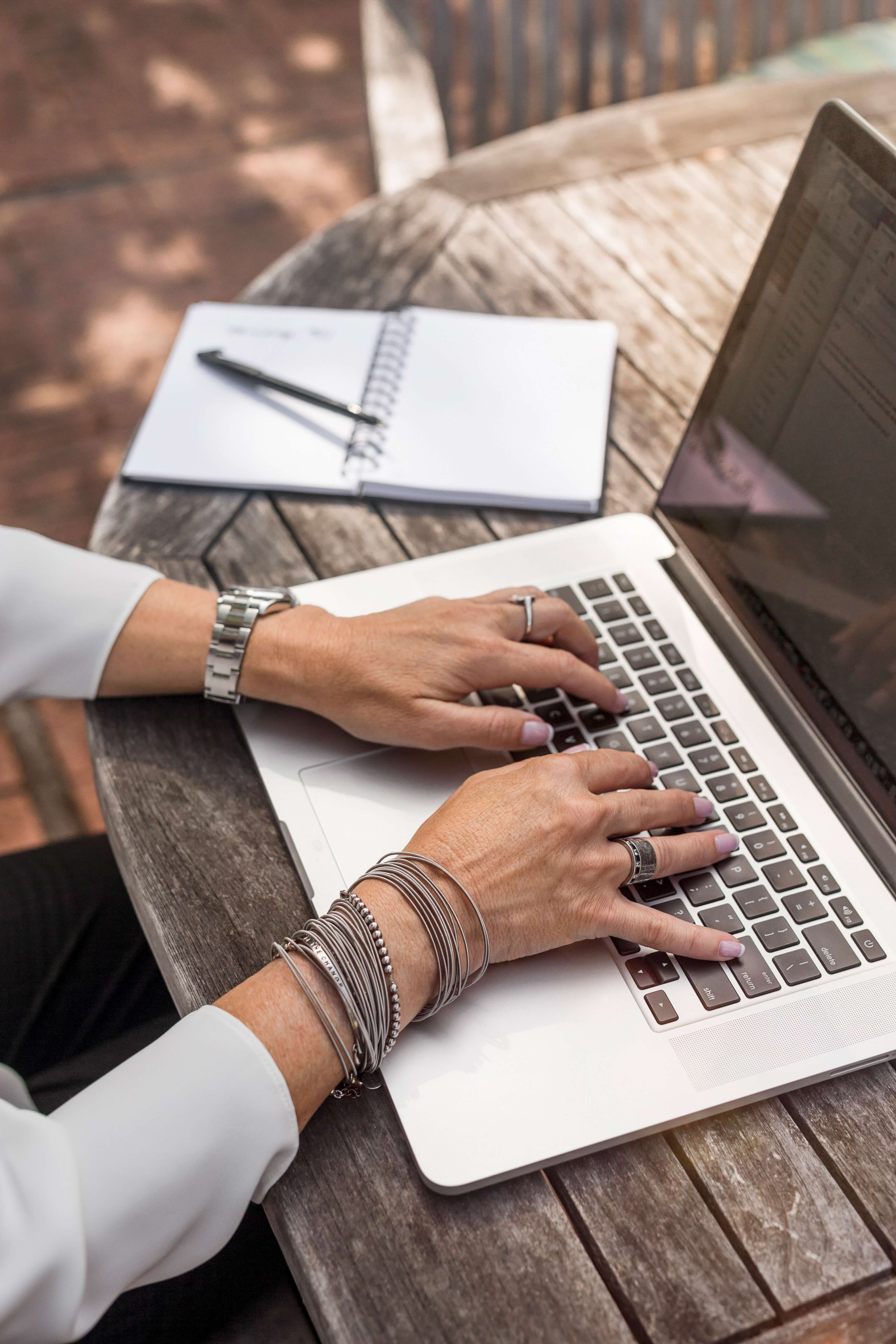 close up of woman using laptop computer