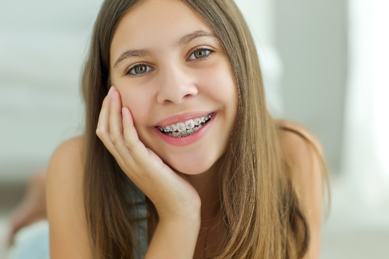 Teen girl smiling with braces
