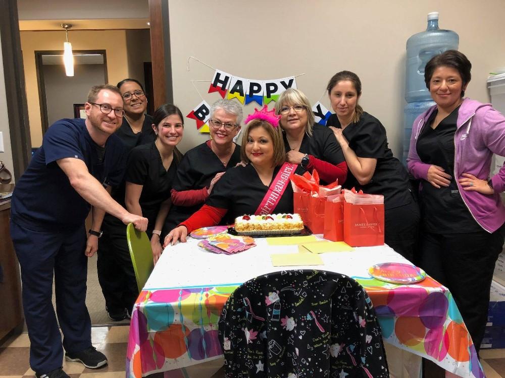 team picture celebrating someone's birthday