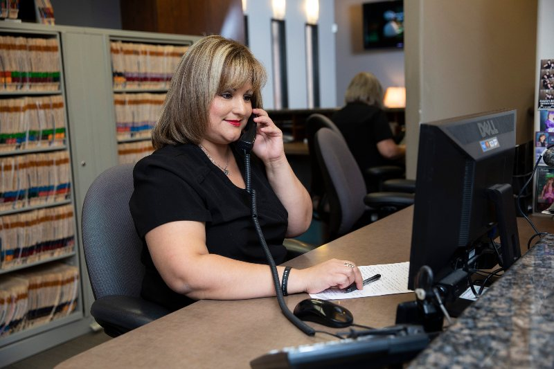 receptionist on phone smiling