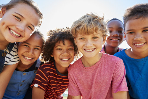 Group of children smiling and looking at camera