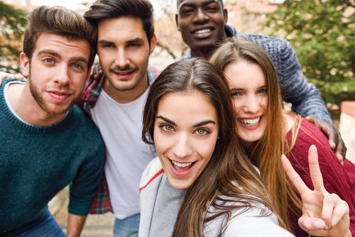Group of friends smiling at a camera