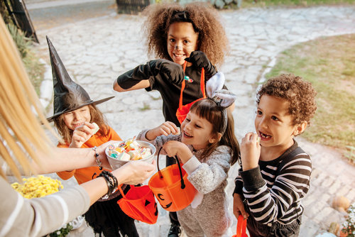 Children trick or treating for candy on Halloween
