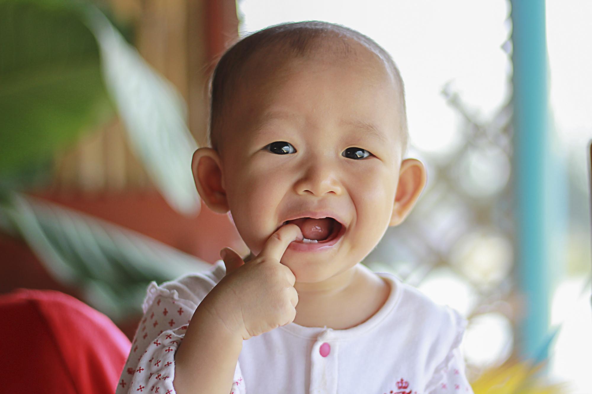 Toddler with tender gums