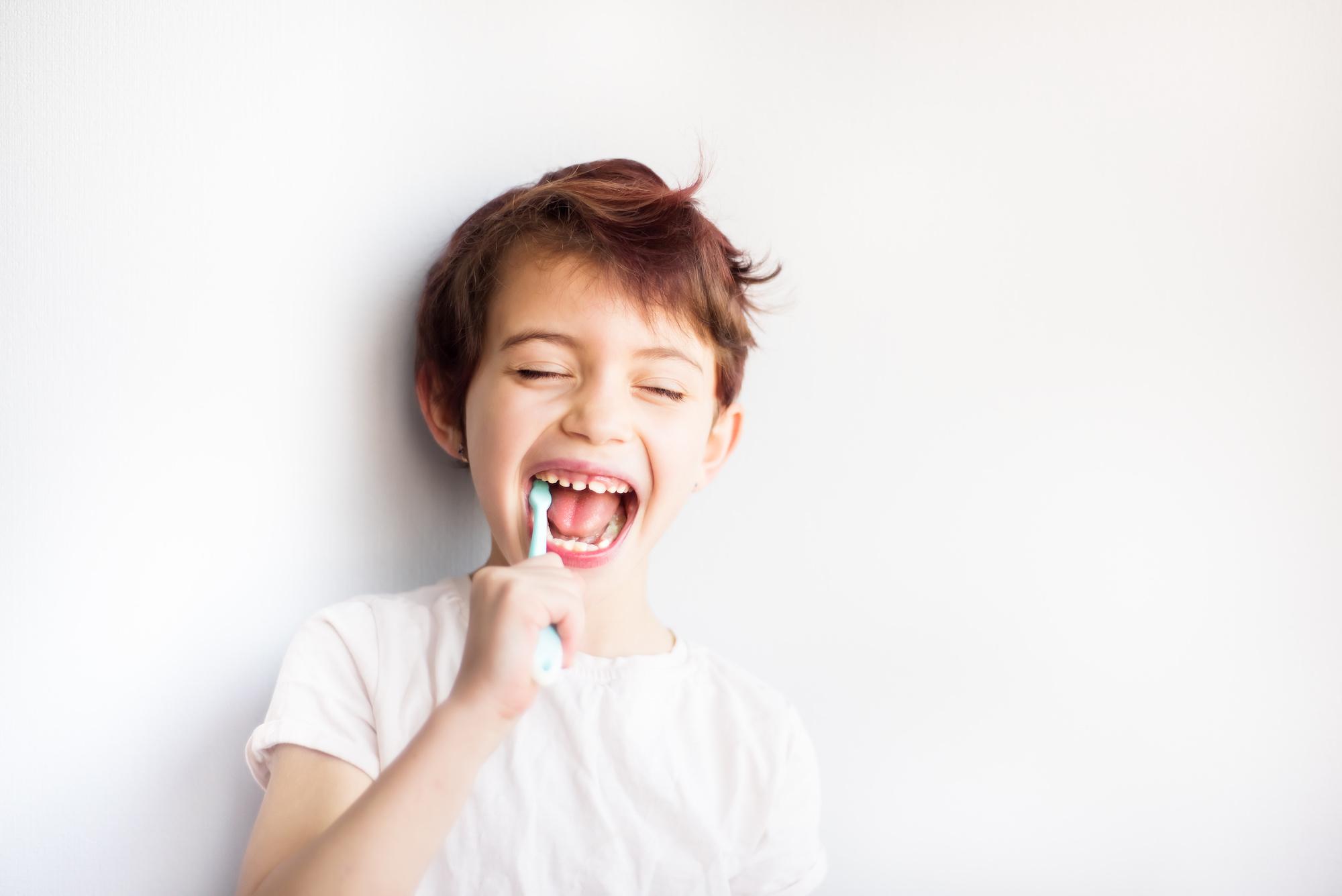 child brushing his own teeth