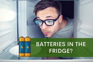 Man looking at Double A Bulk Batteries inside the refrigerator