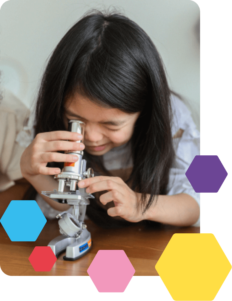 Girl at summer school during a mad science session using a microscope